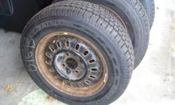 Four winter tires in great shape. Mounted on a Ford four bolt rim. Tire size P185/70R14. Price is for all rims and tires. May sell separte? E-mail for information.