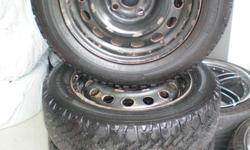 4 snow tires on steel rims; 5/32 tread left; probably good for 1 season; 3 rims are from '99 Honda 14x5J; 1 rim after market 14x5-1/2J; includes 4 Honda hub caps in fair shape and 20 wheel lug nuts plus 1 Toyota hub cap. Tires originally purchased from