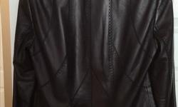 Danier Italian leather jacket (Black) Extra Small Size Snap front closure, Folded cuff sleeves, fitted fit Worn twice, regular price was $399, Asking $175 For Immediate response Text/Message Carol at 613-204-9904 OR dinelle.ch@gmail.com