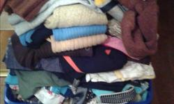2 large bins of woman's clothing used but most like new. Sizes small and medium. Pants and skirts range from sizes 4-6 and jeans are 26-28. Jeans, dress pants, blouses, sweaters, tees, skirts and so much more. Many are brand name Mexx, Nautica, Hollister,