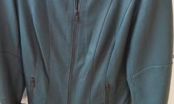 Danier leather jacket (Teal) Ladies Small Size Fitted Fit Zipper front closure, Folded cuff sleeves with zippers & 2 front zipper pockets Never worn, regular price was $249, Asking $150 For Immediate response Text/Message Carol at 613-204-9904 OR
