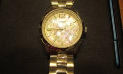 Brand new mint condition women's Guess watch with Mother of Pearl face, water resistant stainless steel construction and contains day, date and 24 hour chronograph settings.