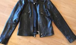 This is a worn-look leather biker jacket. This jacket has served me well for MANY years, but unfortunately no longer closes around my more... Shapely.... Figure! It features snaps around the hem and neck, and on the cuffs. As well as a double zipper and