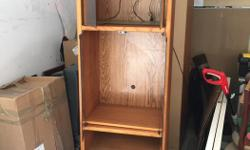 Very solidly built wood cabinet.