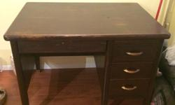 Selling this wonderful desk that is just too big for my new place. It is in great condition, just the usual wear and tear. The long skinny drawer is lockable and also if that drawer is closed, you can't open the other ones so it's great for privacy! I
