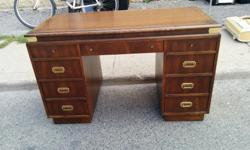 Elegant 9 drawer wood desk with gold accents. Minor scratch on the front, with some simple TLC it can be like new. From Storage. Dimensions 2.75ft H, 4.2 ft W, 2.1 ft D $150 or best offer