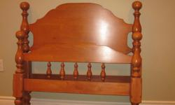 Solid wood bed frame. Includes the headboard, foot board and rails. Excellent condition.