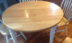 Large format table and four chairs. Table top is solid wood with painted base and chair legs. Paint in chairs needs light sanding and repaint. Table is very solid. Love the surface for kneading dough or rolling out pastry. We are getting ready for a move