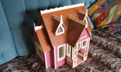 One small wooden doll house fully finished,for 10.00 dollars...337-2127