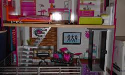 Barely ever used like new Wooden Doll House with all the accessories. My daughter doesn't use it and I need the space.