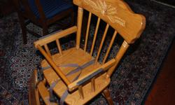 1) Solid wood high chair with metal hardware and safety straps. Made in the U.S. 2) Adjustable crib/bed bumper rail. Both items in new condition. High chair: $130 Bumper rail: $30 Both for $140.