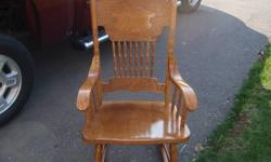 We are selling a wooden rocking chair that we have had for a few years but due to a lack of space we are selling it. Pictures are included and the chair is in great shape as it was hardly used. You will have to pick it up as we don't deliver.   Email with