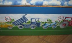 "Wooden Toybox with Cushioned Cover Painted with tractors and cushioned top is clouds Very nice Son wants to get something else!!! Size: 29"" long X 16"" wide $30 Can meet in west end of ottawa (kanata) or pickup in Constance Bay"