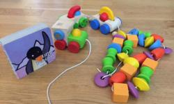 These are good quality wooden toys by Plan Toys. There is a train and a wooden beaded necklace. Both are good condition, also this comes with a Penguin book too. From a pet free, smoke free home.