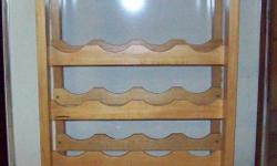 """THIS WINE RACK TABLE IS SOLID WOOD - SLIGHTLY WORN ON TOP.   IT IS APPROX. 23 1/2"""" LONG (LEFT TO RIGHT)                             11 1/4 """" WIDE (FRONT TO BACK)   - HOLDS ABOUT 12 WINE GLASSES, DEPENDING ON THE SIZE   - HOLDS 16 BOTTLES AND HAS A TOP"""