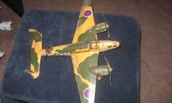This twin engine world war 2 plane is made of steel.  Propellers and wheels are made of steel and are in working condition.  This plane is in good condition.  A great addition to any collection. Approximate size is 13 inches in length x 19 inches in