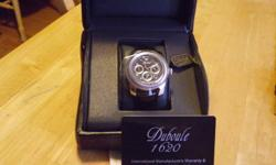 Beautiful stainless automatic watch for sale. Duboule Thornhill 2007 black leather strap and skeleton back , engraved movement . Brand new in box w/ papers Gorgeous dress watch!