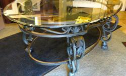 Thank you for your interest in our Wrought Iron Coffee Table. * Excellent condition * Wrought iron base * Glass top * Measures: 22 inches H, x 48 inches W, 33 inches D Hours: * Tues 11 - 4 pm, * Wed & Thurs 11 - 7 pm (open nights), * Fri 11am - 4pm, * Sat