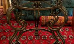 Thank you for your interest in our Wrought Iron Side Table. * Two available * Excellent condition * Wrought iron base * Glass top * Measures: 28 inches H, x 28 inches W, x 28 inches D Hours: * Tues 11 - 4 pm, * Wed & Thurs 11 - 7 pm (open nights), * Fri
