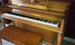 Wurlitzer mahogany upright piano with matching bench. 40 year old piano in very good condition. Same owner - location Timmins