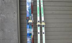 FREE: Two Pair Older style Cross-country skis, 210cm, 195cm. One pair POLES. The shorter pair of skis are wood, the longer is fiberglass. (The other items in attached photo have been picked up.)