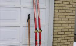 x-country skis 215 cm, Rautiainen antislip ari-glass, made in Finland bamboo poles 140 cm boots Salitkein size 10 all in very goood conditions