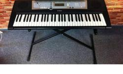 n great condition , come with stand, manual and  adapter.      Yamaha PSR E203  is a music keyboard that transcends the piano. First you've a selection of 134 digitally-sampled voices to deliver authentic sounds of different instruments. Then there are