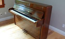 """Yamaha M1A Continental Style Upright Piano in excellent condition with beautiful mahogany finish.  43"""" high.  Matching bench. Made in Japan in 1984 for the North American market.  Serial # R3866932. Piano has rarely been used in 20 years, and kept in a"""