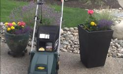 Electric lawnmower in like new condition. Great for smaller yards. Price includes a 100 foot extension cord .