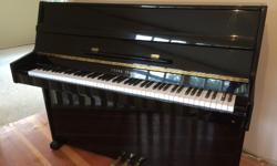 """Young Chang Upright Piano E101 for sale. Black lacquer finish, high gloss. 43"""" high, 53"""" long, 20"""" wide. Comes with matching piano bench. Great condition, plays beautifully."""