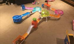 4 working Zhu Zhu pets that move & make 'talking/chirping' noises. Habitats, tunnels, hampster wheel, slide, car & more. Some clothing for them included. Great condition & comes from a smoke free home.