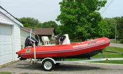 Zodiac Pro inflatable 13ft 9in. x 6ft. wide. Well cared for. Tubes replaced in app. 2002 and  Evinrude E Tech 60 HP installed new in 2006. Comes with custom made trailer, full tarp and centre station cover, stereo, marine radio, compass and bimini. Engine
